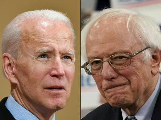 Joe Biden (L) leads the overall race with 878 delegates over Bernie Sanders' 725 (R). There are 105 delegates at play in Georgia