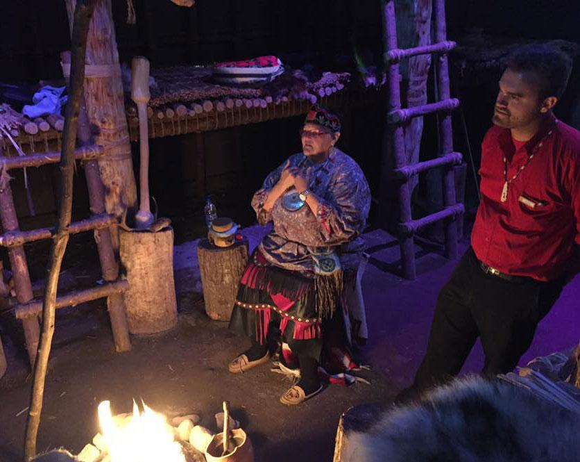 A First Nations Elder serenades us with song while huddled around a fire in a Huron-Wendat Long House (Rob Young)