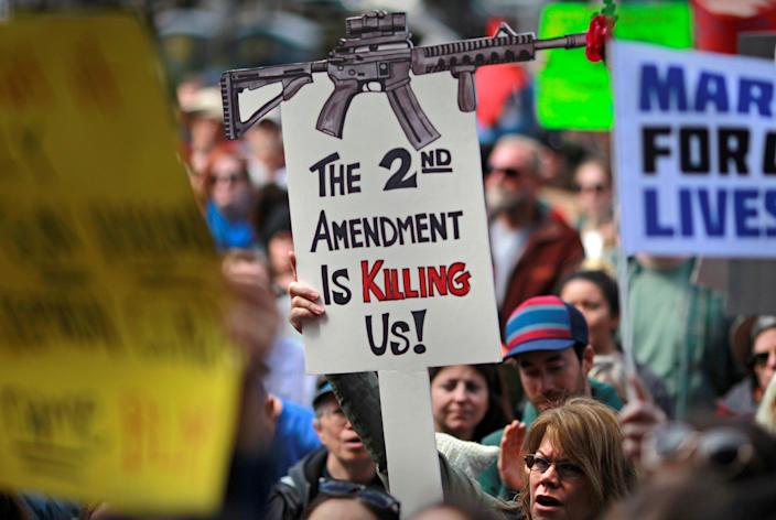 "Protestors hold signs during a ""March For Our Lives"" demonstration demanding gun control in Sacramento, California, U.S. March 24, 2018."