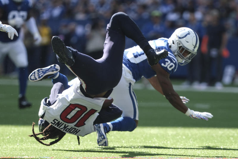 Houston Texans wide receiver DeAndre Hopkins (10) makes a catch while being tackled by Indianapolis Colts' George Odum (30) during the first half of an NFL football game, Sunday, Oct. 20, 2019, in Indianapolis. (AP Photo/AJ Mast)