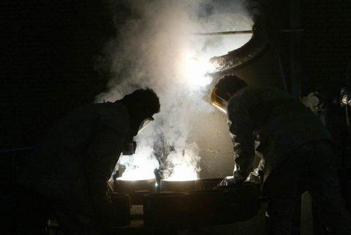 Two technicians at the zirconium production plant in southern Iran. Iranian Foreign Minister Ali Akbar Salehi has announced that long-stalled talks with world powers are to be revived on April 13 at a place yet to be agreed