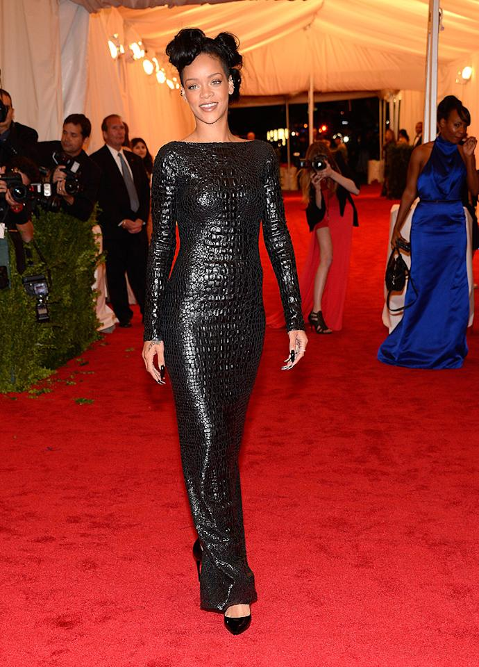 "<p class=""MsoNoSpacing"">Rihanna was rather tame in long-sleeved black textured gown designed by Tom Ford, which featured a low-cut back.</p>"