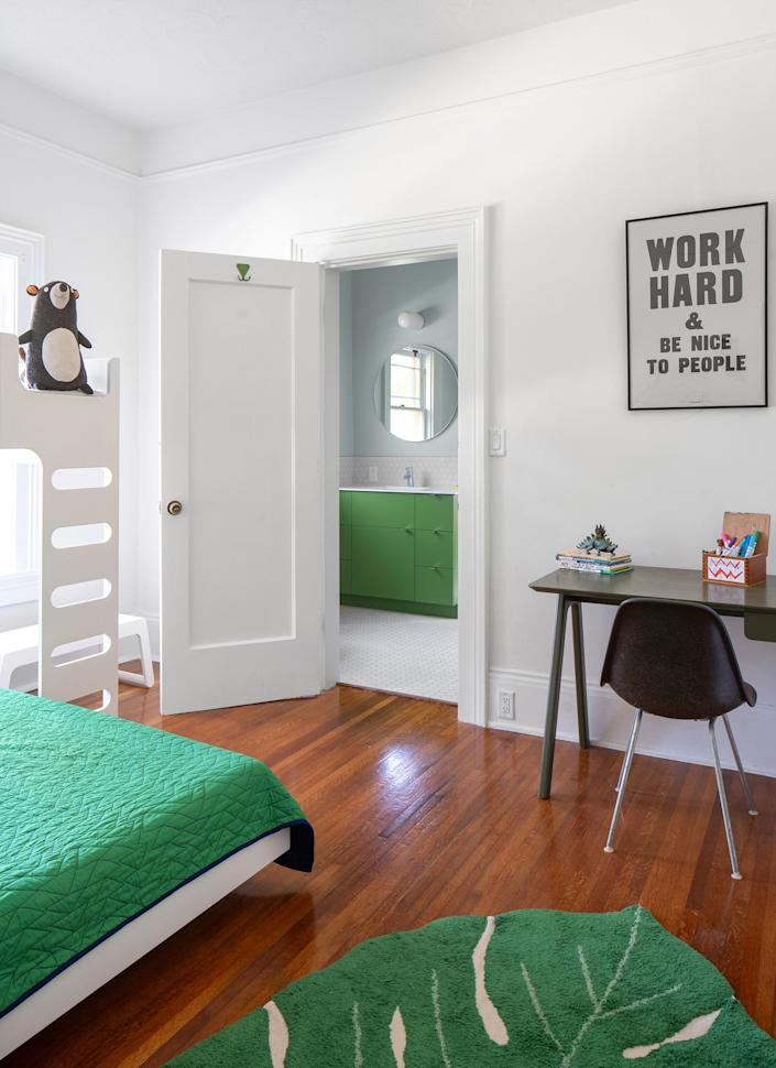 "<div class=""caption""> The kids' bedroom maintains the bright white walls but is full of bright pops of green, which carry through into the bathroom. The cool, modern bunk bed is from <a href=""https://www.rafa-kids.com/product/f-bunk-bed/"" rel=""nofollow noopener"" target=""_blank"" data-ylk=""slk:Rafa Kids"" class=""link rapid-noclick-resp"">Rafa Kids</a>. </div>"