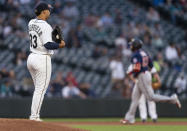 Seattle Mariners starting pitcher Justus Sheffield waits as Minnesota Twins' Nelson Cruz runs the bases after hitting a three-run home run during the fifth inning of a baseball game Wednesday, June 16, 2021, in Seattle. (AP Photo/Stephen Brashear)