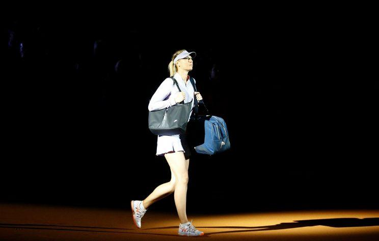 Maria Sharapova arrives on court for her first match since being suspended for 15 months. (REUTERS)