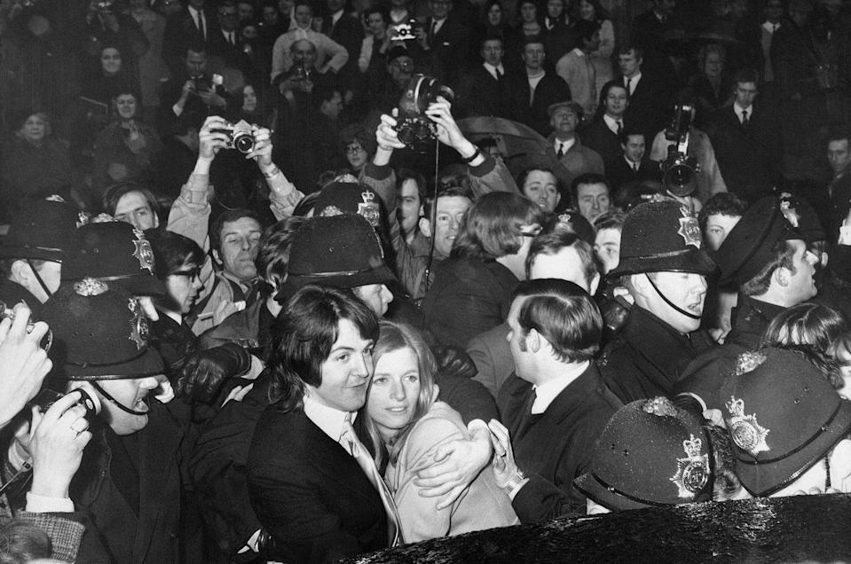 <p>A hoard of photographers capture <em>The Beatles</em> member with his new wife, photographer Linda Eastman, after their London wedding in 1969. The two stayed married until her death in 1998. He went on to marry twice more–first, model Heather Mills (2002–2008), then Nancy Shevell (2011 to present).</p>