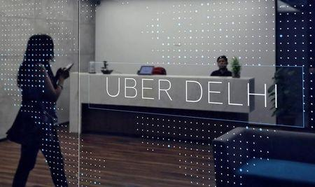 An employee walks inside the office of ride-hailing service Uber in Gurugram, previously known as Gurgaon, on the outskirts of New Delhi, April 19, 2016. REUTERS/Anindito Mukherjee/Files