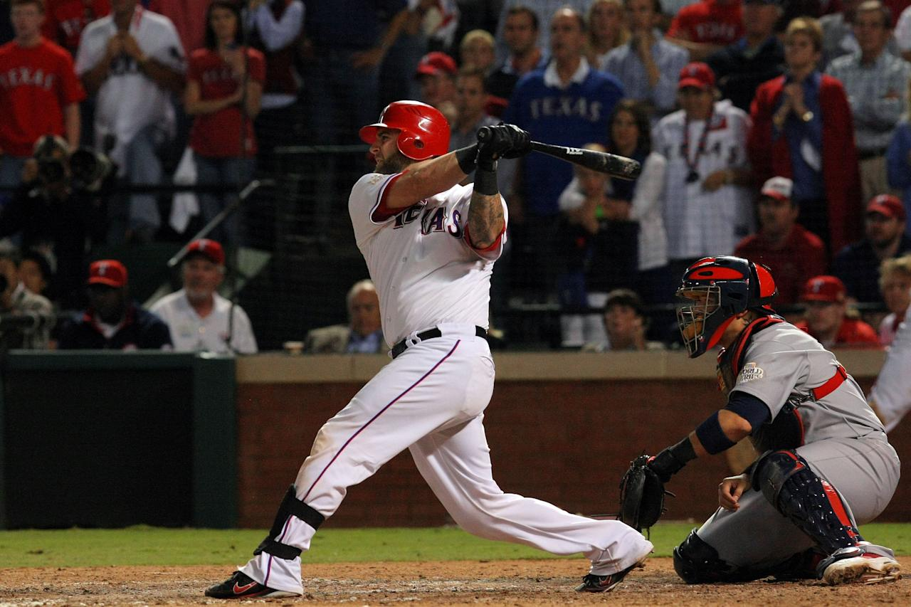 ARLINGTON, TX - OCTOBER 24: Mike Napoli #25 of the Texas Rangers hits a two-run double in the eighth inning during Game Five of the MLB World Series against the St. Louis Cardinals at Rangers Ballpark in Arlington on October 24, 2011 in Arlington, Texas.  (Photo by Tom Pennington/Getty Images)