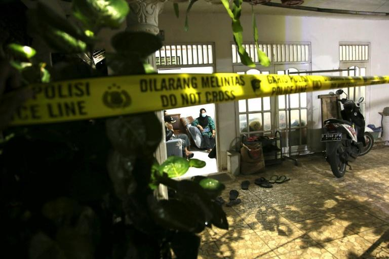 Police tape sealed off the family home of the armed woman who was shot dead by authorities while attacking Indonesia's national police headquarters in Jakarta