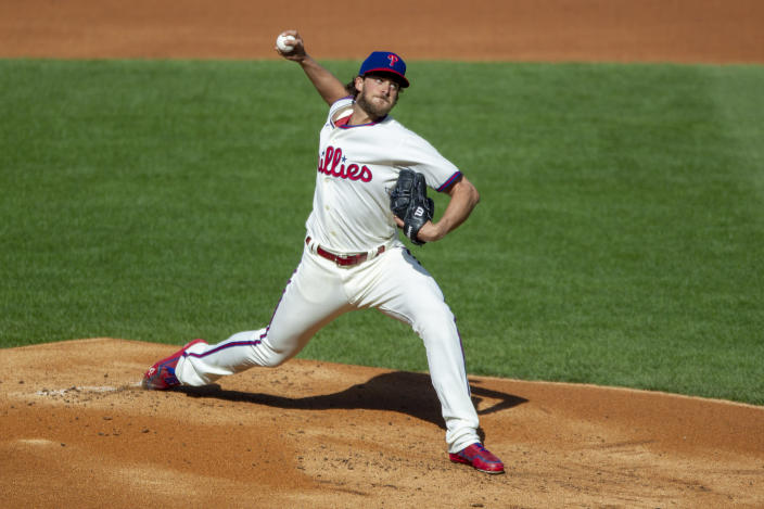 Philadelphia Phillies starting pitcher Aaron Nola (27) throws during the first inning of a baseball game against the New York Mets, Wednesday, April 7, 2021, in Philadelphia. (AP Photo/Laurence Kesterson)