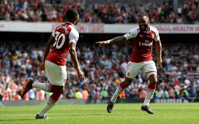 """Beginning with a match that ranks among the more irrelevant of your 34-year career was never likely to get the celebratory tour off to a particularly rousing start, but three goals in the final 10 minutes did at least ensure a positive end to an otherwise easily forgettable match. The final headline act for Arsene Wenger's Arsenal tenure really starts with the Europa League first leg against Atletico Madrid, but a rather flattering win here against West Ham United should at least boost confidence, especially in Alexandre Lacazette and Aaron Ramsey, ahead of Thursday night. With Burnley also held by Stoke City on Sunday, Arsenal are now almost assured of finishing at least sixth to avoid the pre-season disruption for Wenger's successor that Europa League qualifying would cause. Wenger's send-off will now depend entirely on whether he can rouse three more big performances from his players in the Europa League, and so depart Lyon next month with a trophy and Arsenal back in the Champions League. On this evidence, it is far from certain. With West Ham resilient and roared on, among others, by centre-back James Collins in the away end, Arsenal summoned only one shot on goal during a first half played at almost a pre-season pace in the London heat. It was most notable for what looked like a significant injury to their Egypt midfielder Mohamed Elneny. He eventually left the pitch on a stretcher in tears and a protective brace that makes him a doubt not just for the remaining Europa League matches, but perhaps also the World Cup. Elneny's injury will now be X-rayed, but Wenger said simply that """"it does not look good"""". Wenger was given a good reception Credit: Getty images David Ospina's selection as Arsenal goalkeeper suggests Petr Cech will return on Thursday in the Europa League, but there was also no starting place for club record signing Pierre-Emerick Aubameyang, despite him only being eligible this season for Arsenal in the Premier League. The rationale was clearly th"""