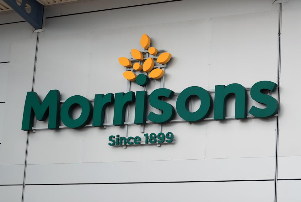 File photo dated 19/06/20 of a sign for the Morrisons. Morrisons has revealed that profits were cut by more than half over the past year after it was hit by �290 million in pandemic-related costs. Issue date: Thursday March 11, 2021.