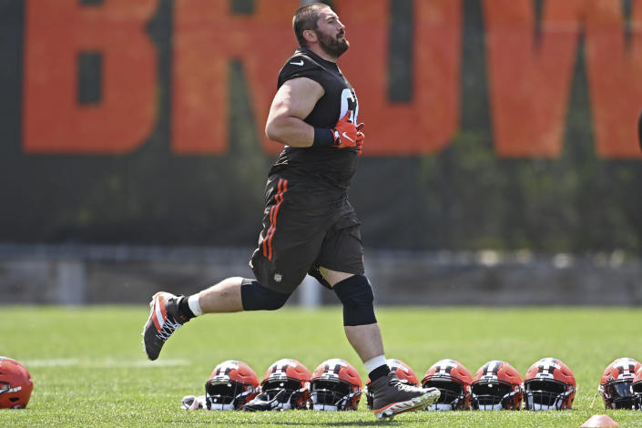 """FILE - Cleveland Browns offensive lineman JC Tretter runs during an NFL football practice at the team training facility in Berea, Ohio, in this Tuesday, June 15, 2021, file photo. Tretter is president of the NFLPA. """"I know we have learned to work in a very difficult environment, and we will do it again,"""" NFL commissioner Roger Goodell said. """"That is one of the things we learned ... hearing clubs and the NFLPA saying our relationship has never been stronger. I interpret that as a trust that has been built here that will take us forward and will be the long-lasting legacy of this season."""" (AP Photo/David Dermer, File)"""