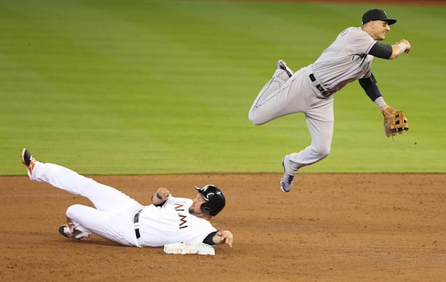 MIAMI, FL - APRIL 03: Shortstop Troy Tulowitzki #2 of the Colorado Rockies cannot turn a double play against Casey McGehee #9 of the Colorado Rockies during the first inning at Marlins Park on April 3, 2014 in Miami, Florida. (Photo by Marc Serota/Getty Images)