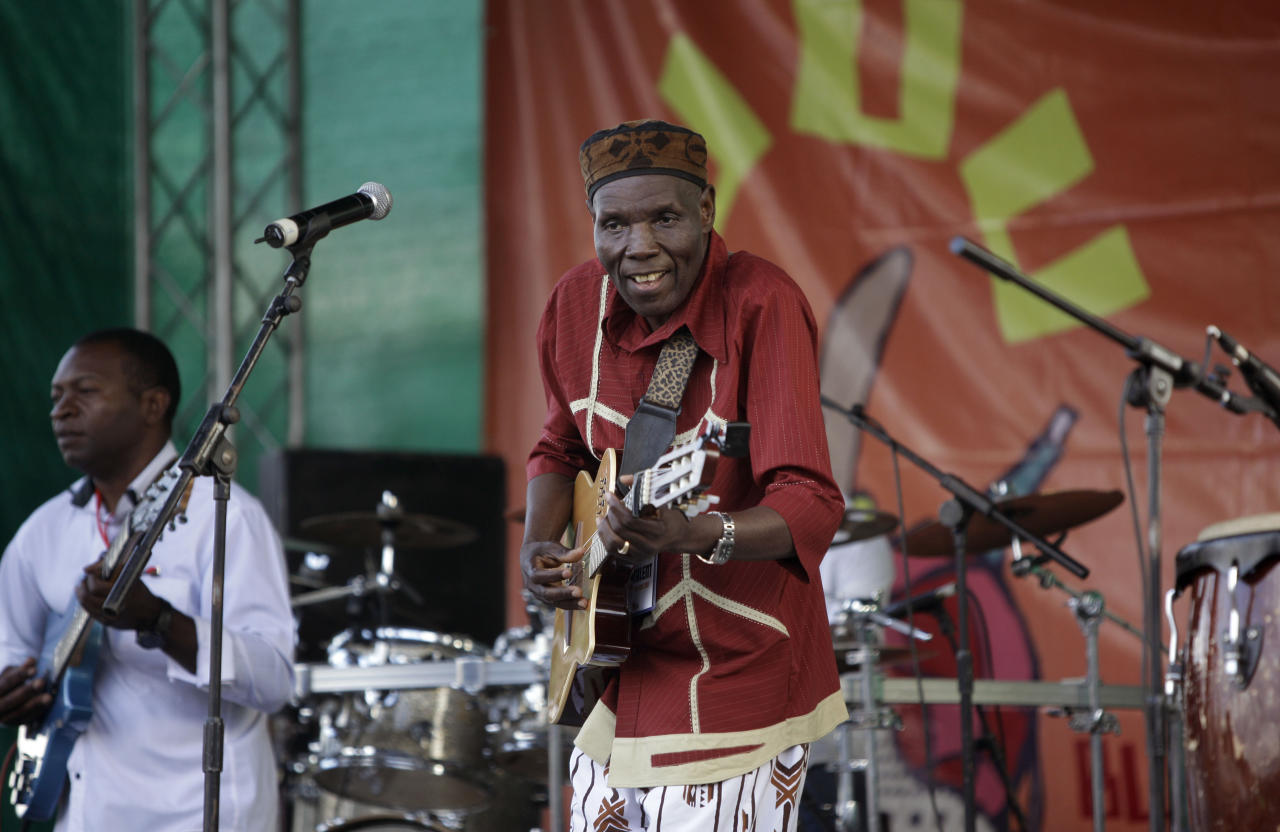 FILE - In this Sunday, Nov. 6, 2011 file photo, Zimbabwean music superstar and U.N. goodwill ambassador Oliver Mtukudzi, center, performs at a music festival held in Karen on the outskirts of Nairobi, Kenya. Zimbabwean musician and world music star Oliver Mtukudzi dies in Harare at age 66, it was announced Wednesday, Jan. 23, 2019. (AP Photo/Ben Curtis, file)