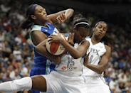 New York Liberty forward Kara Braxton (45) fights for possession of the ball against Minnesota Lynx guard Ta'Shauna Rodgers (15) in the first half of a WNBA basketball game, Sunday, Aug. 18, 2013, in Minneapolis. (AP Photo/Stacy Bengs)