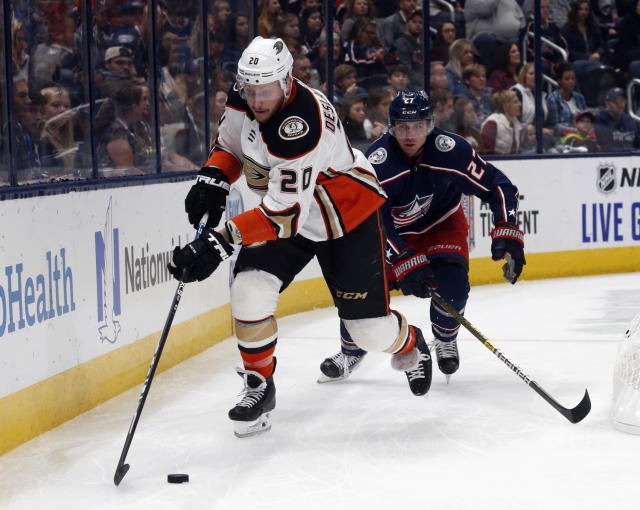 Anaheim Ducks forward Nicolas Deslauriers, left, controls the puck in front of Columbus Blue Jackets defenseman Ryan Murray during the first period of an NHL hockey game in Columbus, Ohio, Friday, Oct. 11, 2019. (AP Photo/Paul Vernon)