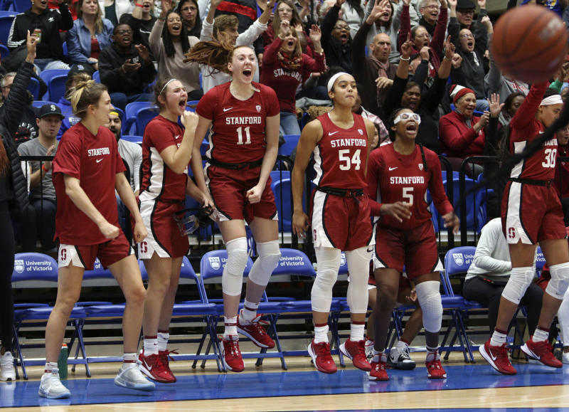 Stanford players celebrate a basket from the bench against Mississippi State during the third quarter of an NCAA college basketball game in Victoria, British Columbia, Saturday, Nov. 30, 2019. (Chad Hipolito/The Canadian Press via AP)