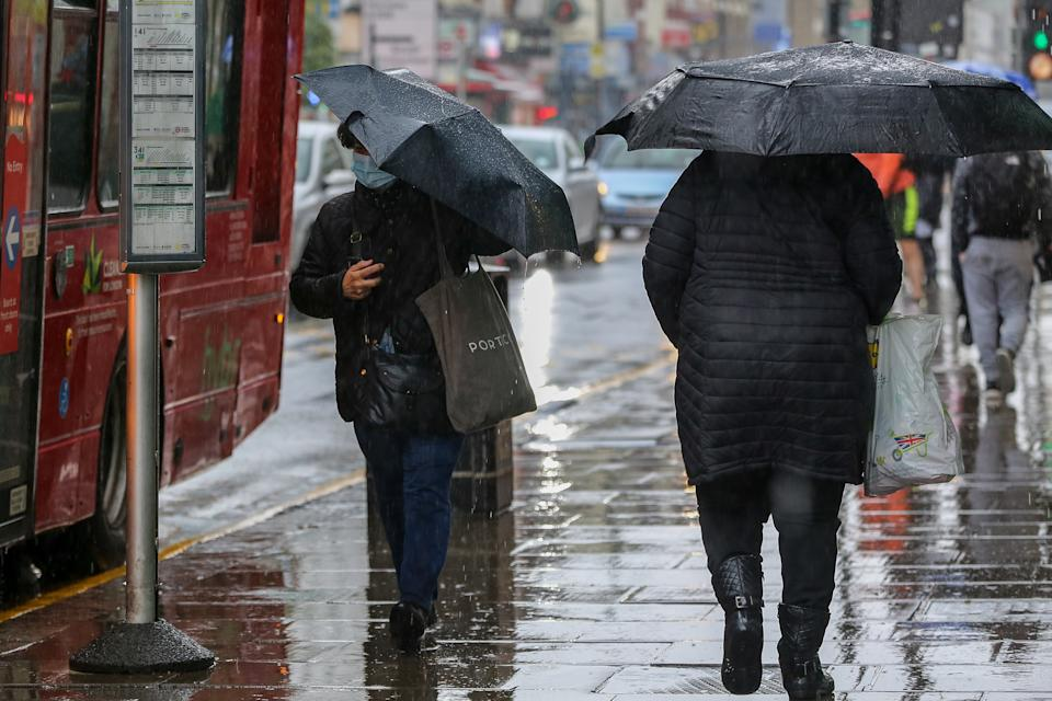 People walk along the Streets while holding umbrellas during a Rainy Day. (Photo by Dinendra Haria / SOPA Images/Sipa USA)