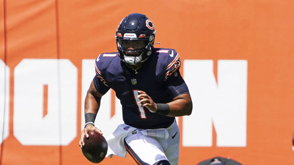 Chicago Bears quarterback Justin Fields (1) plays against the Miami Dolphins during an NFL preseason football game in Chicago, Saturday, Aug. 14, 2021. (AP Photo/David Banks)
