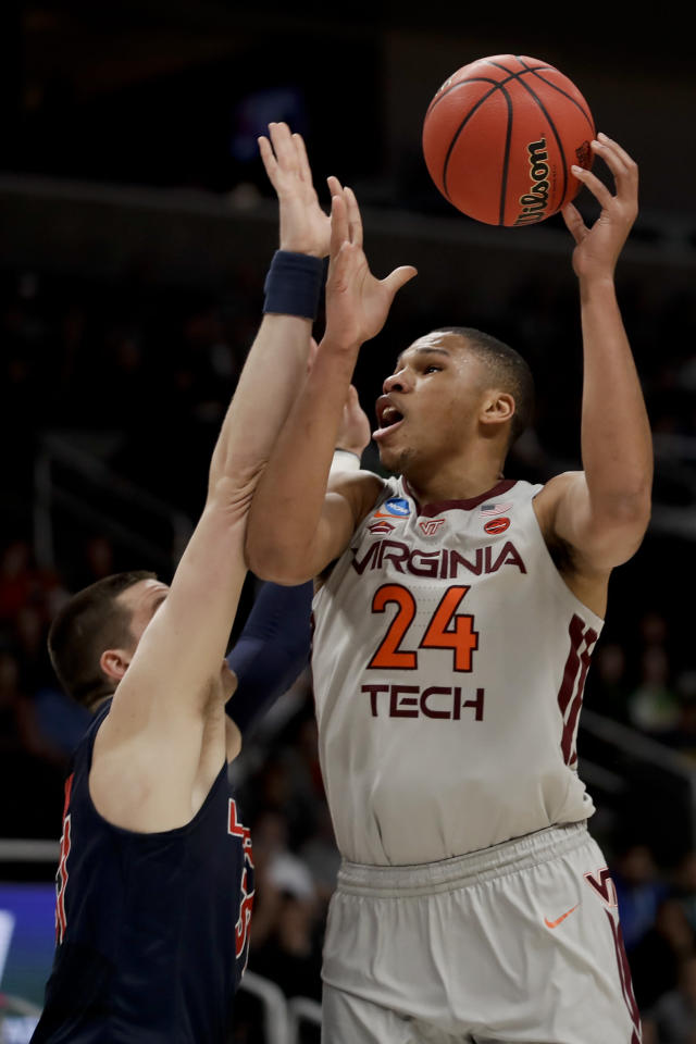 Virginia Tech forward Kerry Blackshear Jr., right, shoots over Liberty forward Scottie James during the first half of a second-round game in the NCAA men's college basketball tournament Sunday, March 24, 2019, in San Jose, Calif. (AP Photo/Ben Margot)