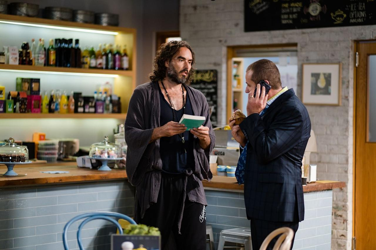 <p>Having visited Erinsborough for the ongoing writers' festival, Russell passes comment on Toadie's eating habits and his reliance on his mobile phone.</p>