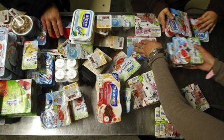 Volunteers line up yogurt boxes to be distributed at Casa NGO in Azeitao