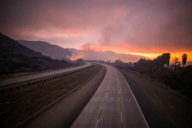 "Route 101 closed after the ""Thomas Fire"" jumped the road in Ventura, California"
