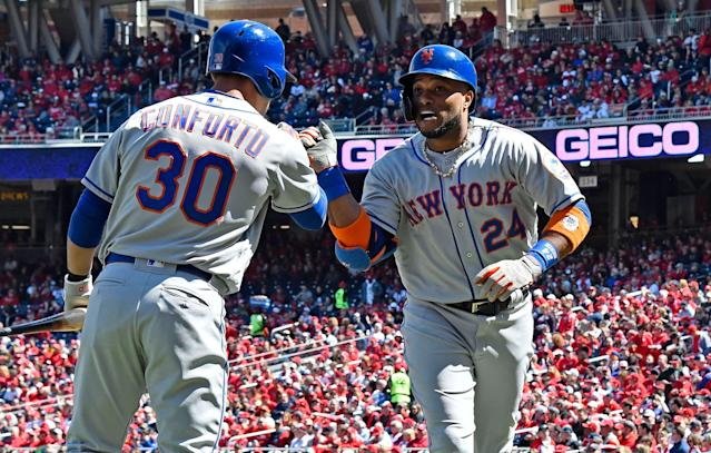 Mar 28, 2019; Washington, DC, USA; New York Mets second baseman Robinson Cano (24) is congratulated by left fielder Michael Conforto (30) after hitting a solo home run against the Washington Nationals during the first inning at Nationals Park. Mandatory Credit: Brad Mills-USA TODAY Sports