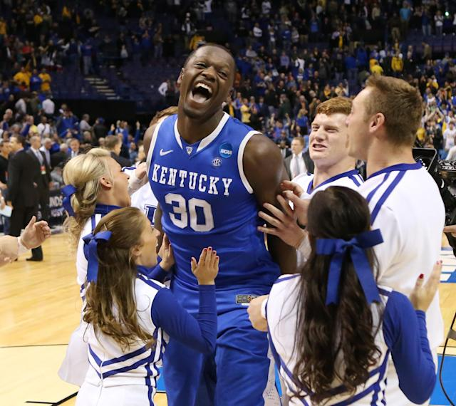 Kentucky forward Julius Randle celebrates with cheerleaders after a Third Round NCAA Tournament game between Wichita State and Kentucky on Sunday, March 23, 2014, at the Scottrade Center in St. Louis. (AP Photo/ St. Louis Post-Dispatch, Chris Lee)