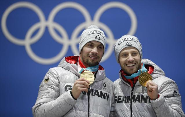 Medals Ceremony - Luge - Pyeongchang 2018 Winter Olympics - Men's Doubles - Medals Plaza - Pyeongchang, South Korea - February 16, 2018 - Gold medalists Tobias Wendl and Tobias Arlt of Germany on the podium. REUTERS/Kim Hong-Ji