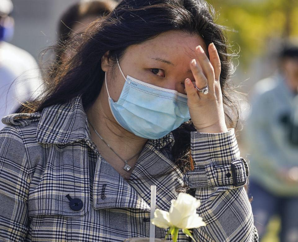 "<span class=""caption"">A woman tears up as she attends a community rally in Los Angeles to raise awareness of anti-Asian violence and racist attitudes, in response to the string of violent racist attacks against Asians during the pandemic.</span> <span class=""attribution""><span class=""source"">(AP Photo/Damian Dovarganes)</span></span>"