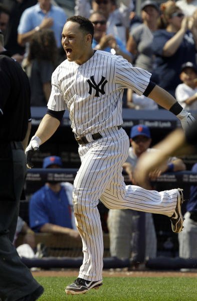 New York Yankees' Russell Martin reacts while running between third and home after hitting a ninth-inning walk-off solo home run in the Yankees' 5-4 victory over the New York Mets in a baseball game at Yankee Stadium in New York, Sunday, June 10, 2012. (AP Photo/Kathy Willens)
