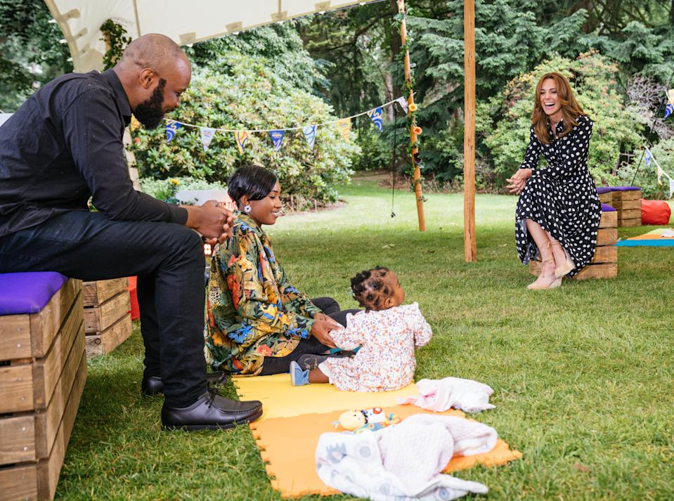 EMBARGOED TO 2230 MONDAY JULY 13 Undated handout photo issued by Kensington Palace of the Duchess of Cambridge (right) with Abu, Henrietta and their 11 month daughter Amirah, to mark the launch of a new BBC education resource called Tiny Happy People.