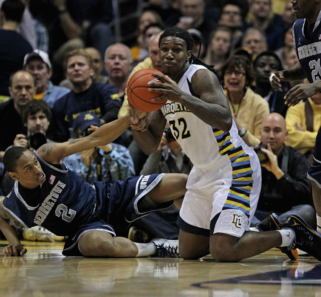 MILWAUKEE, WI - MARCH 03:  Jae Crowder #32 of the Marquette Golden Eagles grabs a loose ball away from Greg Whittington #2 of the Georgetown Hoyas at the Bradley Center on March 3, 2012 in Milwaukee, Wisconsin. Marquette defeated Georgetown 83-69.  (Photo by Jonathan Daniel/Getty Images)