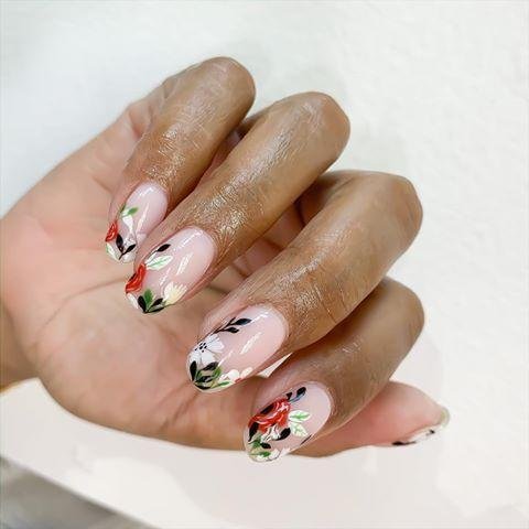 """<p>Painterly floral designs on a milky base coat give a classic mani a modern twist.</p><p><a href=""""https://www.instagram.com/p/B8xvoqngfJE/?utm_source=ig_embed&utm_campaign=loading"""" rel=""""nofollow noopener"""" target=""""_blank"""" data-ylk=""""slk:See the original post on Instagram"""" class=""""link rapid-noclick-resp"""">See the original post on Instagram</a></p>"""
