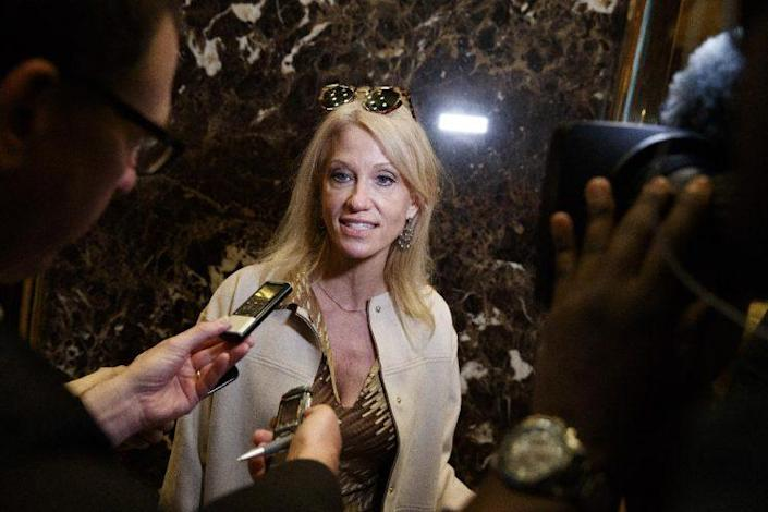 Kellyanne Conway, campaign manager for President-elect Donald Trump, talks with reporters as she arrives at Trump Tower on Monday. (Photo: Evan Vucci/AP)