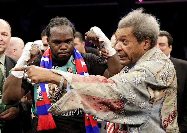 Bermane Stiverne, left, celebrates his win over Chris Arreola with promoter Don King after a rematch for the WBC heavyweight boxing title in Los Angeles, Saturday, May 10, 2014. (AP Photo/Chris Carlson)