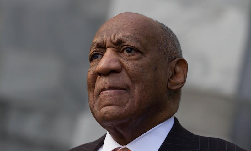 Bill Cosby stands next to his spokesman, Andrew Wyatt, as Wyatt addresses mediaon Tuesday. (Photo: Pacific Press via Getty Images)