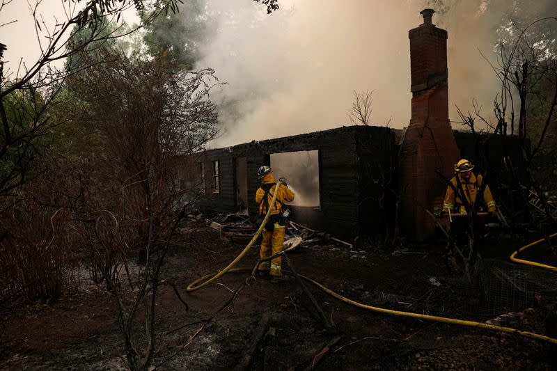 Lightning-sparked fires rage across California, tens of thousands flee