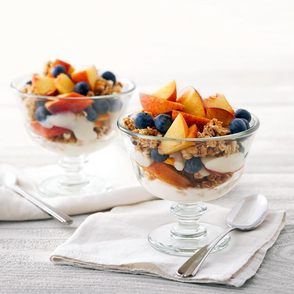 "<p>Layers of flavored yogurt, crunchy cereal, peach, and blueberries in a parfait glass make a quick but satisfying breakfast or snack. <a href=""http://www.eatingwell.com/recipe/264713/peach-blueberry-parfaits/"" rel=""nofollow noopener"" target=""_blank"" data-ylk=""slk:View recipe"" class=""link rapid-noclick-resp""> View recipe </a></p>"