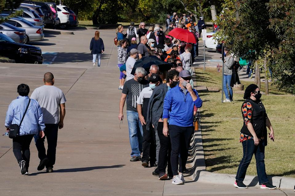 Voters queued for up to five hours to participate in early voting at a polling place in Oklahoma on 30 October. (AP)