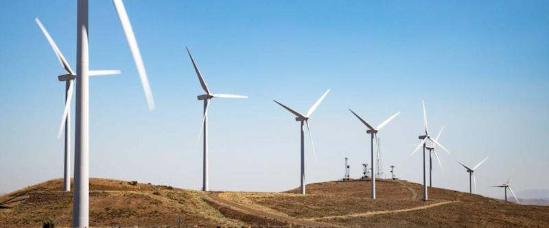 Ellensburg, Washington / USA - 07/12/2018: Turbines spin in the wind at the Wind Turbines at Wild Horse Wind and Solar Engery Center Washington State, 2018
