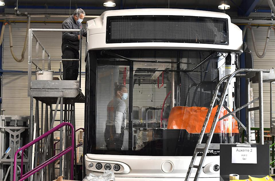 Technicians work on the construction of a hydrogen bus, at the plant of the Albi's Automobile Company for Repair and Manufacturing (Societe Albigeoise Fabrication Reparation Automobile - SAFRA), in Albi, southwestern France, on March 4, 2021. - French national leader in its field, the manufacturer SAFRA has produced