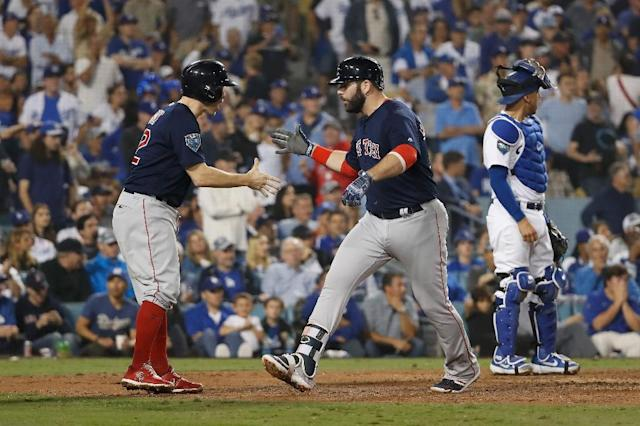 Mitch Moreland (C) of the Boston Red Sox celebrates after hitting a three-run home run in the seventh inning against the Los Angeles Dodgers (AFP Photo/Sean M. Haffey)