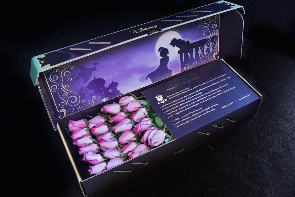 """<p>Show your partner that they've shown you a whole new world with this <a rel=""""nofollow"""" href=""""http://www.roseshire.com/products/jasmine""""><strong>Aladdin</strong> design</a> ($195), which features a dreamy magic carpet scene from the Disney flick and includes two dozen pink roses.</p>"""