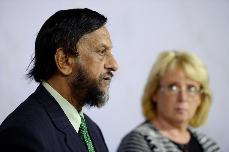 """Rajendra Pachauri, the head of the U.N. Intergovernmental Panel on Climate Change (IPCC), left, and Sweden's Environmental ministers Lena Ek, right, comment on the U.N. IPCC climate report, in Stockholm, Friday Sept. 27, 2013. Scientists can now say with extreme confidence that human activity is the dominant cause of the global warming observed since the 1950s, a new report by an international scientific group said Friday. Calling man-made warming """"extremely likely,"""" the Intergovernmental Panel on Climate Change used the strongest words yet on the issue as it adopted its assessment on the state of the climate system. ((AP Photo / TT / Jessica Gow) SWEDEN OUT"""