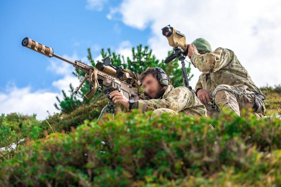 An Italian Special Forces Sniper team engage targets