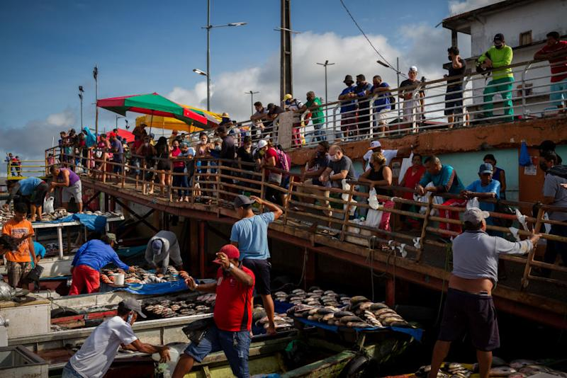 Fishmongers sell their goods from their boats at Porto Manaus Moderna on the banks of the Rio Negro.