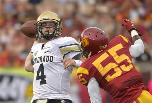 Colorado quarterback Jordan Webb, left, passes under pressure from Southern California linebacker Lamar Dawson during the first half of an NCAA college football game, Saturday, Oct.20, 2012, in Los Angeles. (AP Photo/Mark J. Terrill)